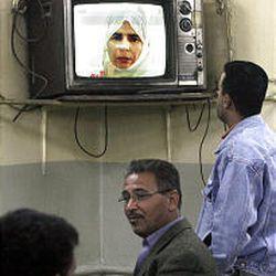 Sajida Mubarak Atrous al-Rishawi explains on camera how she tried to blow herself up with her husband.
