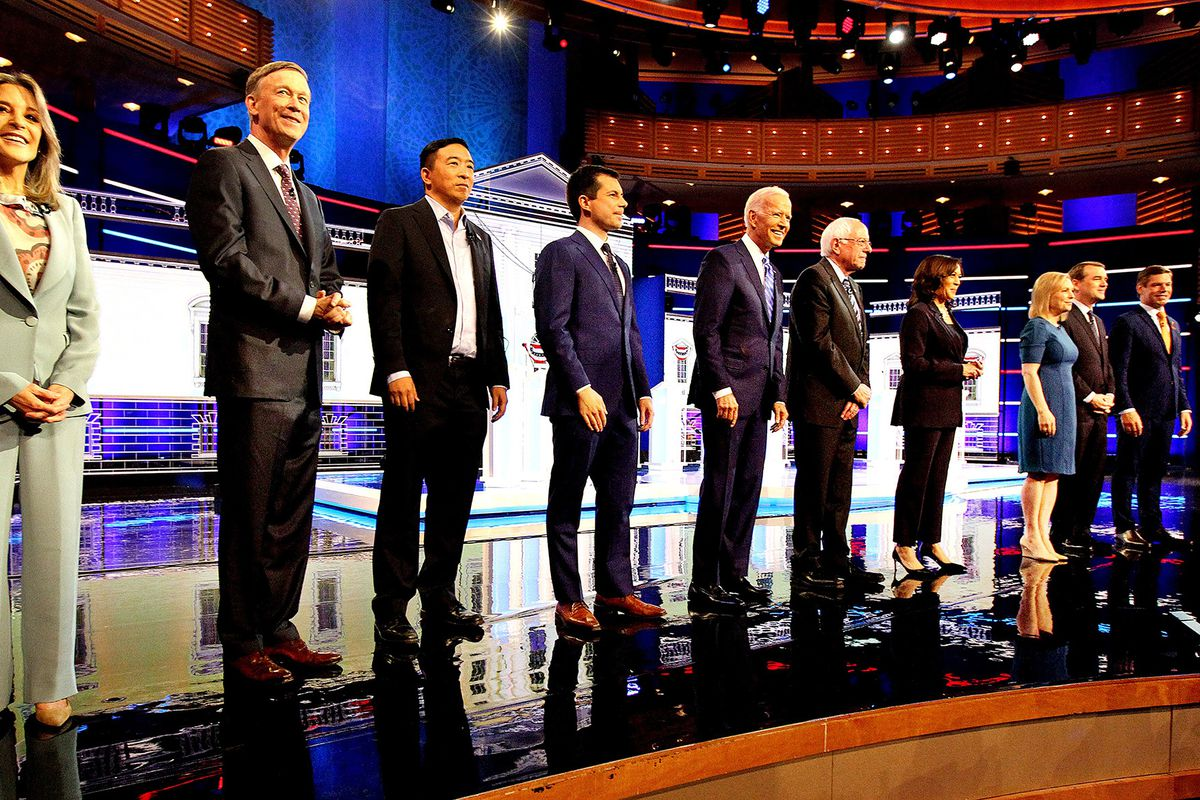 Candidates stand on the stage in a line on the second night of NBC's first round of Democratic presidential primary debates