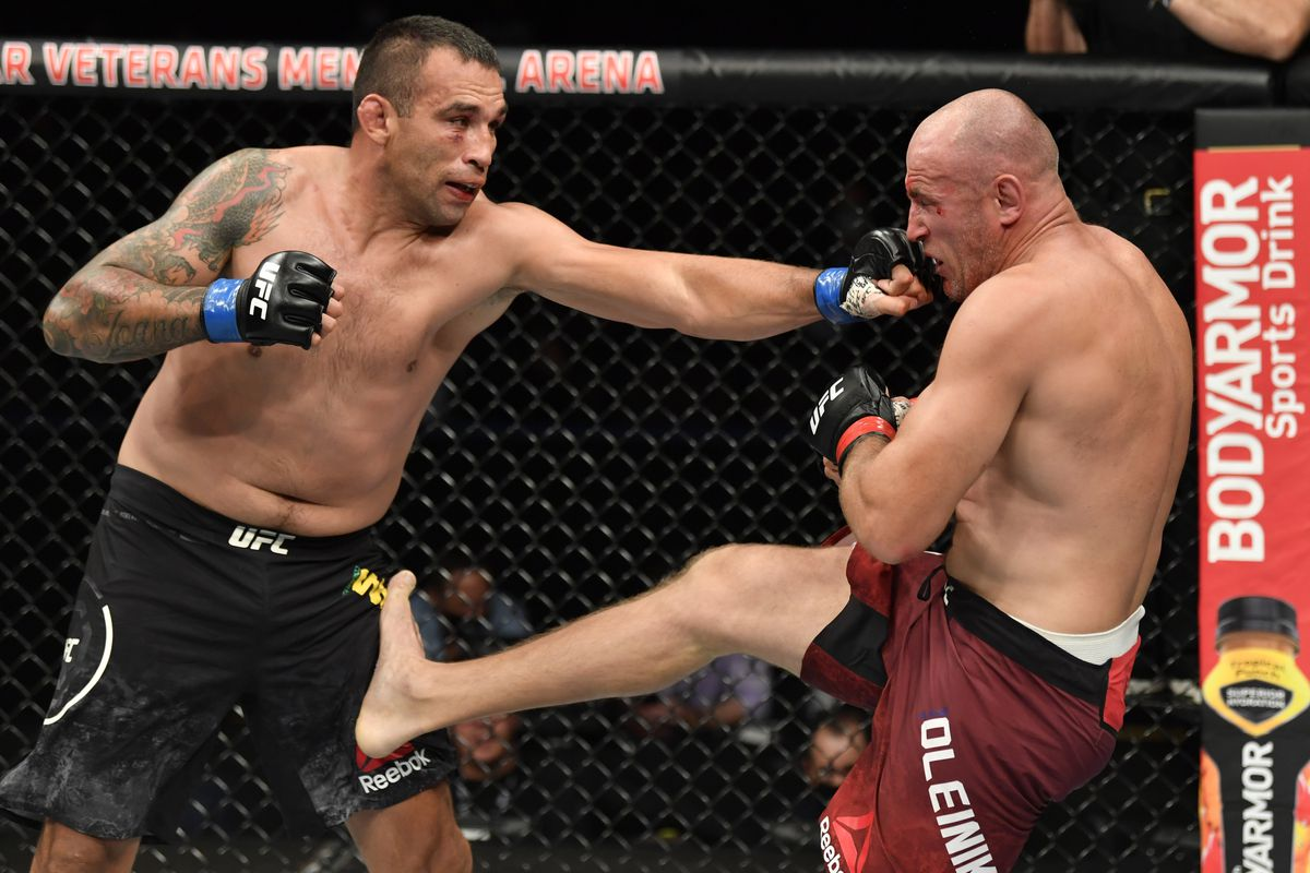 Fabricio Werdum punches Aleksei Oleinik of Russia in their heavyweight fight during the UFC 249 event at VyStar Veterans Memorial Arena on May 09, 2020 in Jacksonville, Florida.
