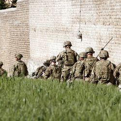 U.S. Army soldiers respond after a suicide attack on the US..-led provincial reconstruction team (PRT) compound in the Behsood district of Jalalabad, east of Kabul Afghanistan, on Sunday, April 15, 15 2012. The Taliban launched a series of coordinated attacks on at least seven sites across the Afghan capital on Sunday, targeting NATO headquarters, the parliament and diplomatic residences. Militants also launched near-simultaneous assaults in three other eastern cities. (AP Phot/Rahmat Gul)