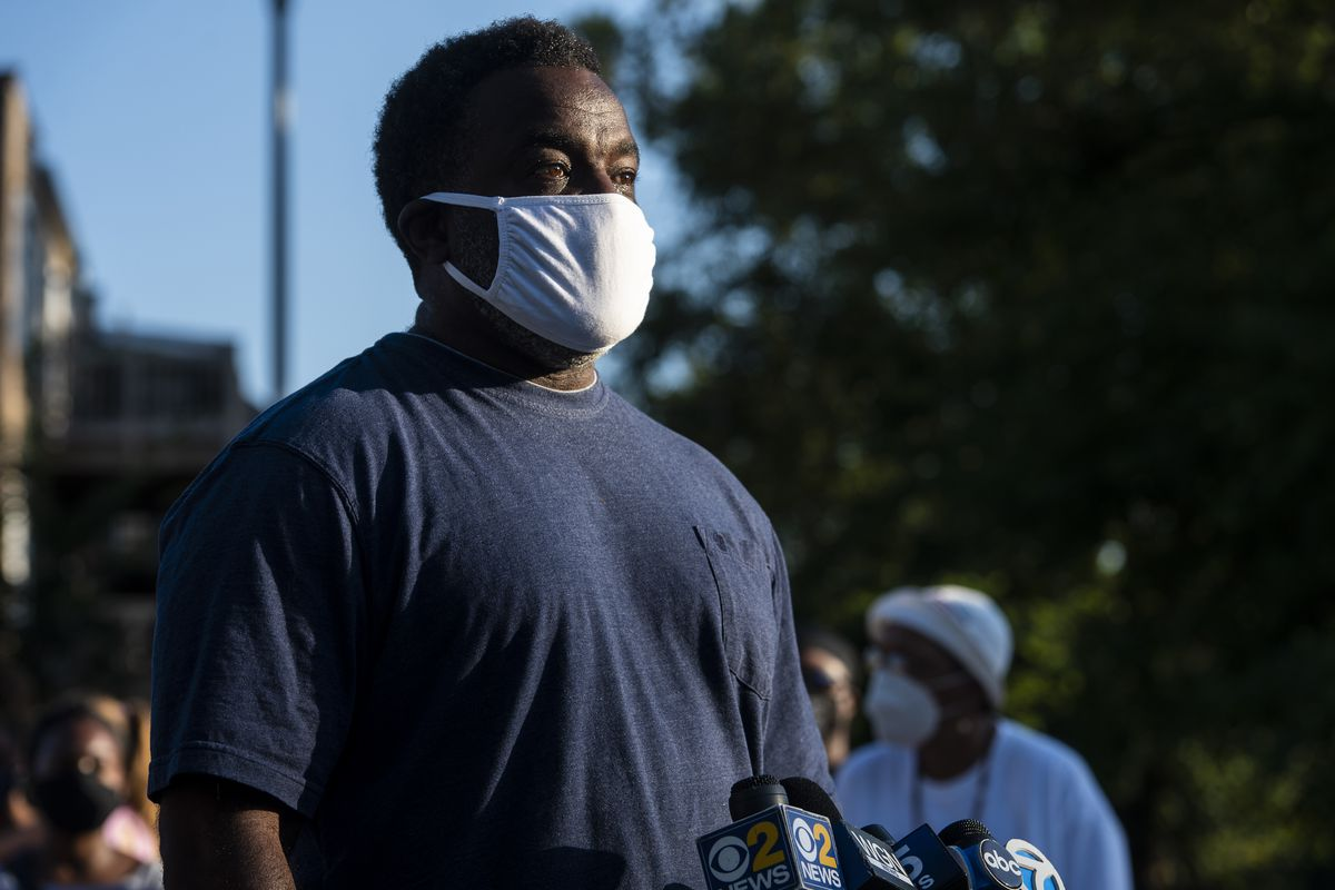 John Shorter, a lieutenant with the Chicago Fire Department, speaks to reporters at Mamie Till Mobley Park where his 12-year-old son was wounded in a shooting, Friday, Aug. 21, 2020. | Tyler LaRiviere/Sun-Times