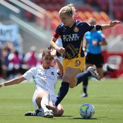 Sky Blue FC defender Estelle Johnson (24) kicks the ball away from Utah Royals FC forward Amy Rodriguez (8) as she works for a shot as the Utah Royals and Sky Blue play in the National Women's Soccer League Challenge Cup at Zions Bank stadium in Herriman on Saturday, July 4, 2020. Utah won 1-0.