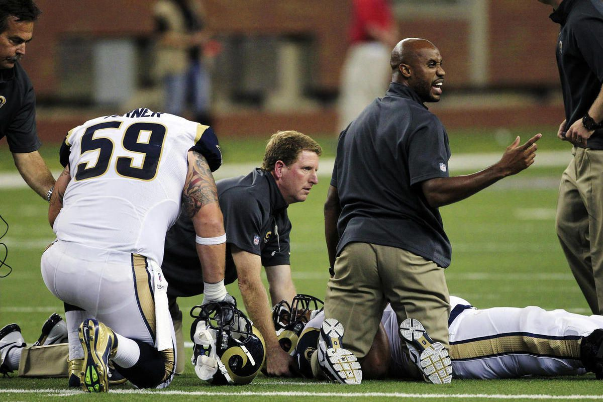St. Louis Rams guard Robert Turner (59) kneels as team officials help tackle Rodger Saffold after he sustained an injury during the fourth quarter of an NFL football game against the Detroit Lions in Detroit, Sunday, Sept. 9, 2012.