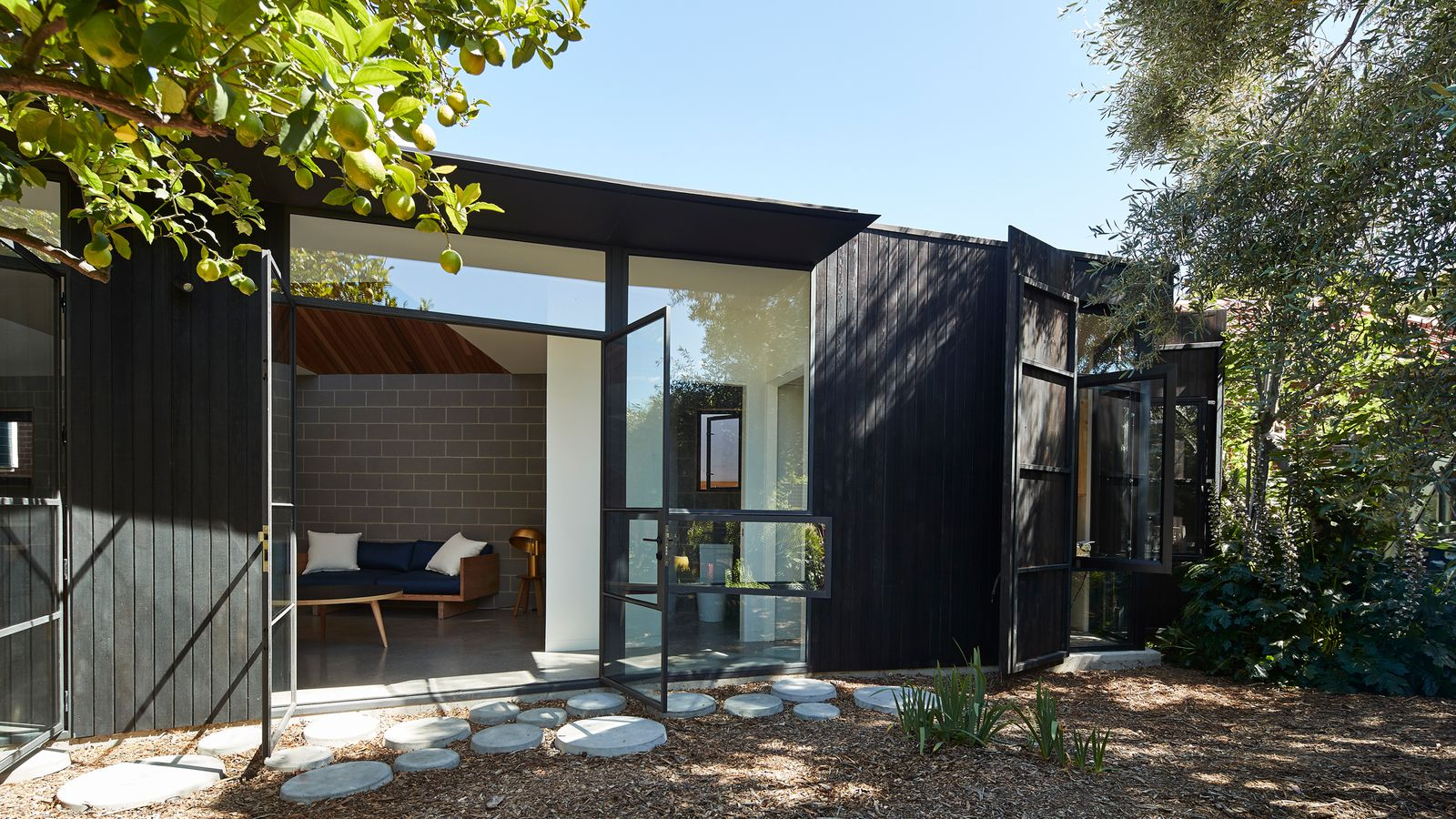 Dark timber house offers refuge for homeowner with sleep ...