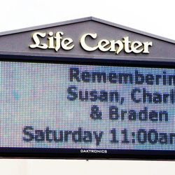 A sign at the Life Center Church in Tacoma, Wash., Friday, Feb. 10, 2012 tells of the memorial for Susan Cox Powell, Charlie Powell and Braden Powell.