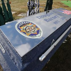 The top the vault that will cover Unified police officer Doug Barney's casket is seen at the Orem City Cemetery on Monday, Jan. 25, 2016, in Orem. Barney was killed in the line of duty on Jan. 17, 2016.