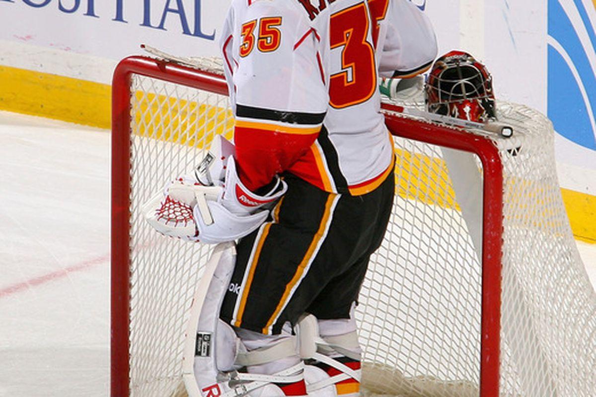 BUFFALO, NY - NOVEMBER 04: Henrik Karlsson #35 of the Calgary Flames takes a break during a timeout against the Buffalo Sabres at First Niagara Center on November 4, 2011 in Buffalo, New York.Buffalo won 2-1.  (Photo by Rick Stewart/Getty Images)