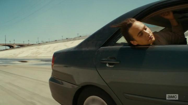 Nick hangs out the window on Fear the Walking Dead.