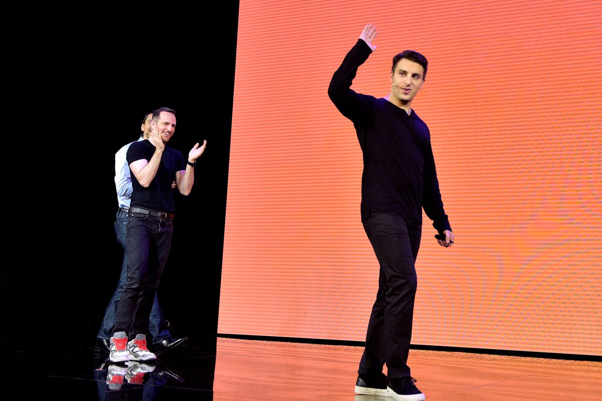 """Airbnb cofounders CTO Nathan Blecharczyk, chief product officer Joe Gebbia and CEO Brian Chesky speak onstage during the """"Introducing Trips"""" reveal at Airbnb Open LA on November 17, 2016 in Los Angeles, California."""