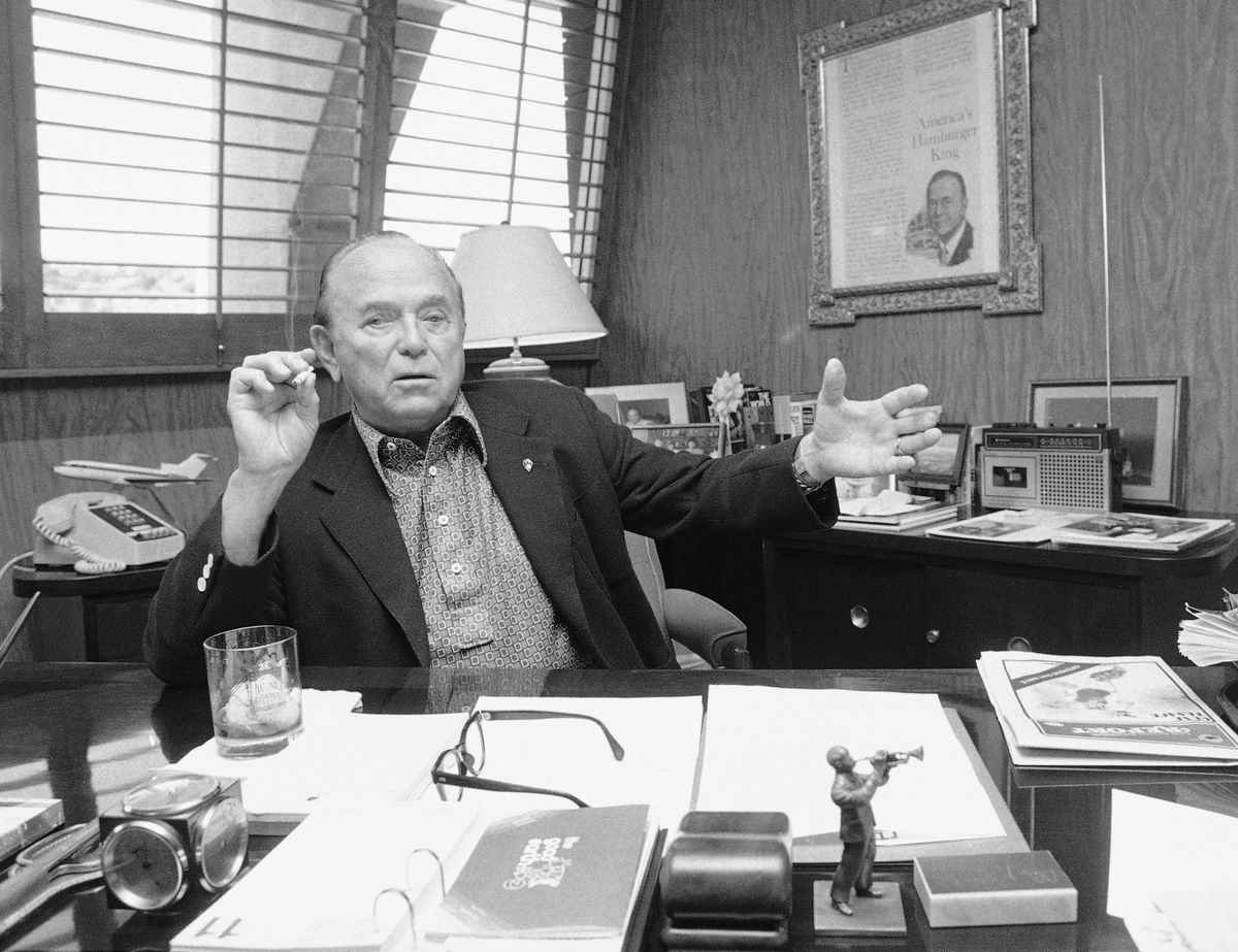 Ray Kroc outside one of his franchises (Getty Images) / Kroc in his office at San Diego Stadium (APPhoto)
