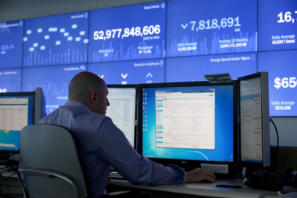 Employees at EnerNOC work in the 'mission control' room, or network operations center, at their hub, in Boston, Massachusetts August 12, 2013. (Melanie Stetson Freeman/The Christian Science Monitor via Getty Images)