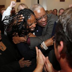 Mia Love, 4th Congressional District Republican candidate, is congratulated by her father, Maxime Bourdeau, as she declares victory on election night in Salt Lake City, Tuesday, Nov. 4, 2014.