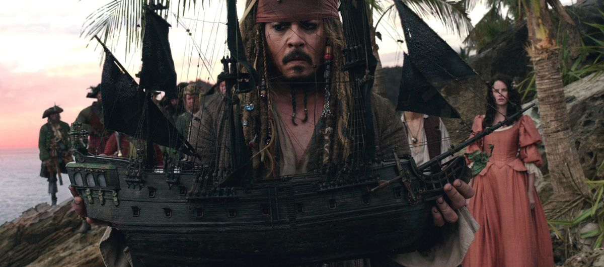 jack sparrow holds a pirates ship in pirates of the caribbean 5 dead men tell no tales