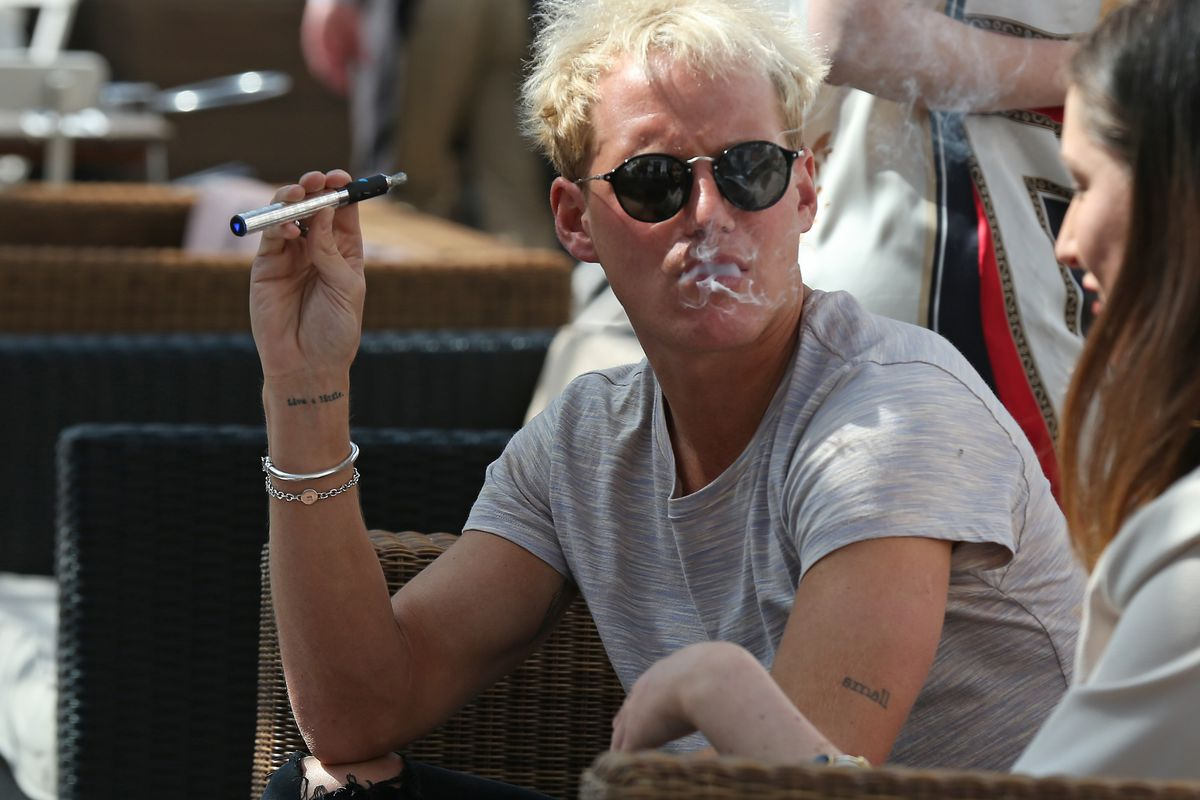 MIC's Jamie Laing spotted vaping on a bespoke blu e-cigarette in London, England.