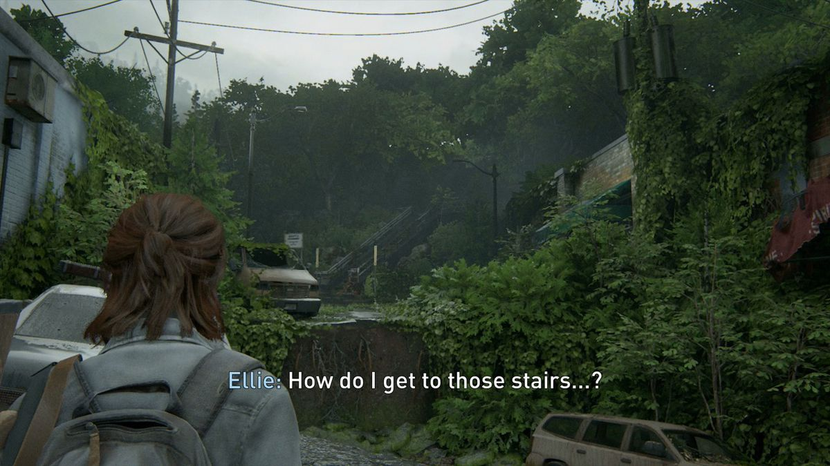 """Ellie looks off into the distance and sees stairs she must get to, and says, """"How do I get to those stairs...?"""""""