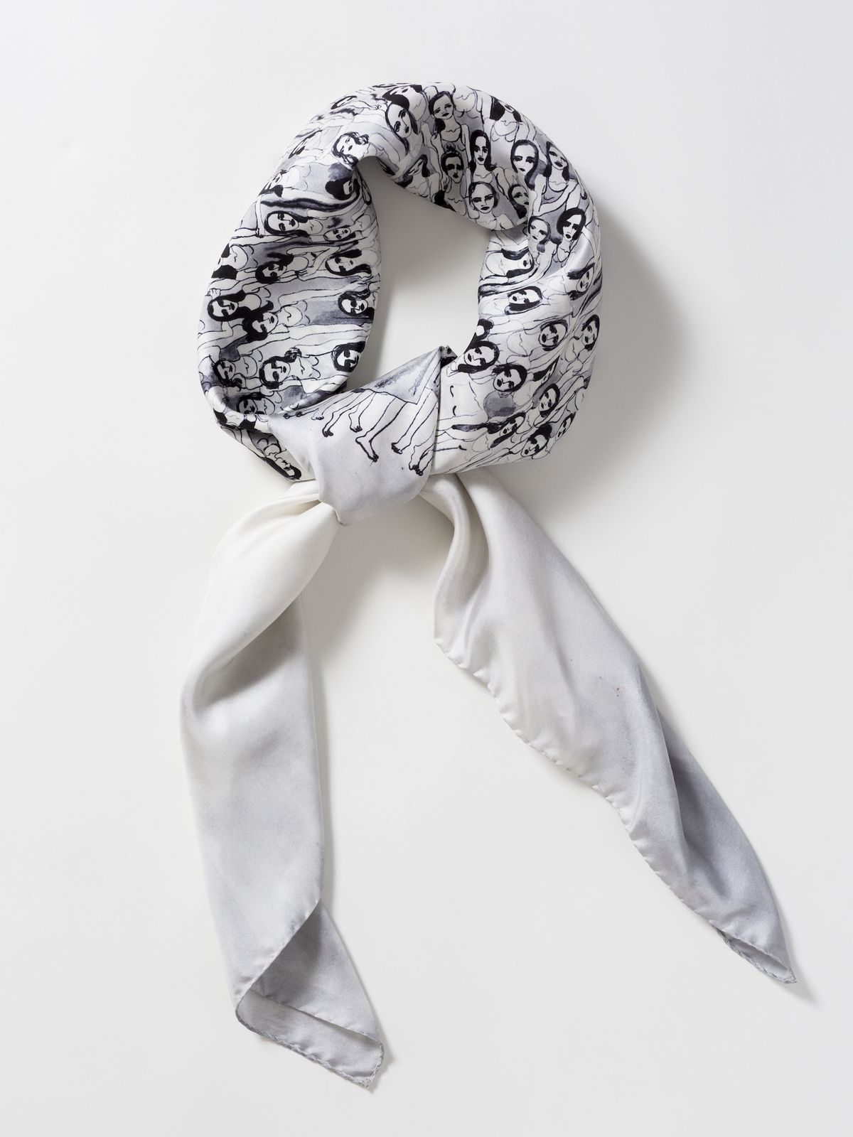 """A close up of Oliva Wendel's """"Performance"""" scarf, depicting women standing together in a group"""