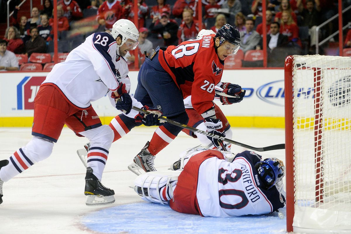 WASHINGTON, DC - SEPTEMBER 26:  Curtis Sanford #30 of the Columbus Blue Jackets makes a save against Alexander Semin #28 of the Washington Capitals at the Verizon Center on September 26, 2011 in Washington, DC.  (Photo by Greg Fiume/Getty Images)