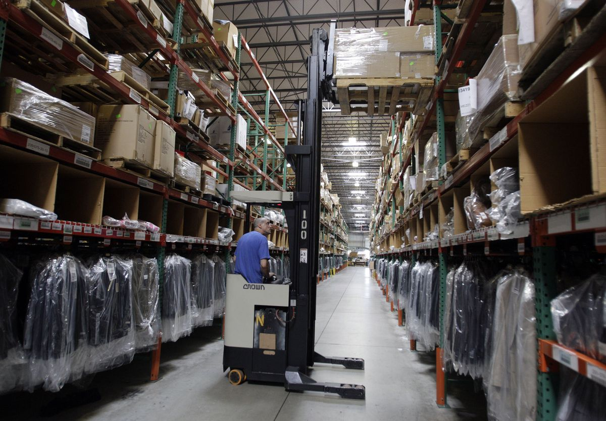 Overstock.Com employee Jeff Owens works at the warehouse in West Valley City Aug. 23, 2011.