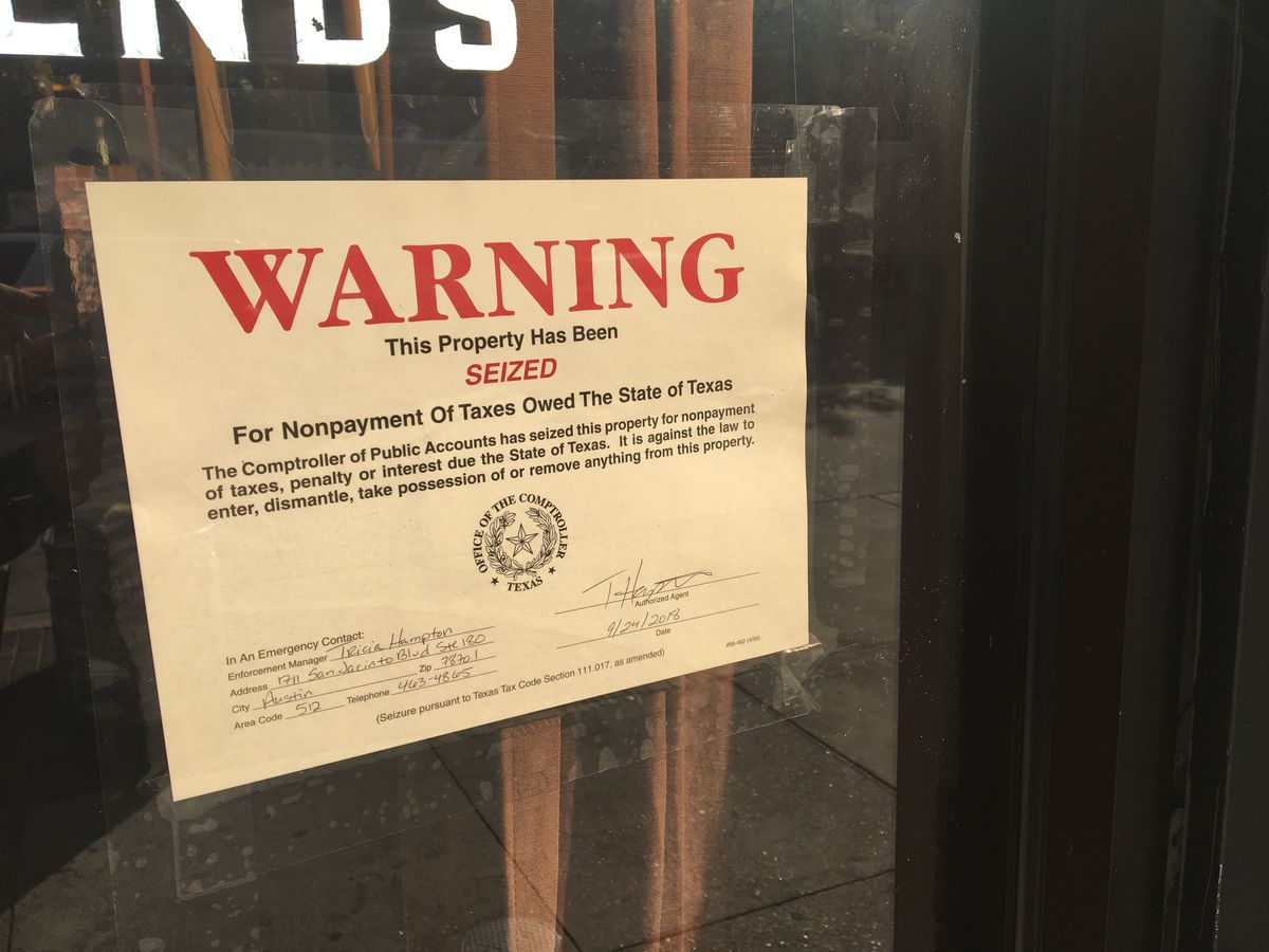 The seizure notice on Frank's doors on Colorado Street