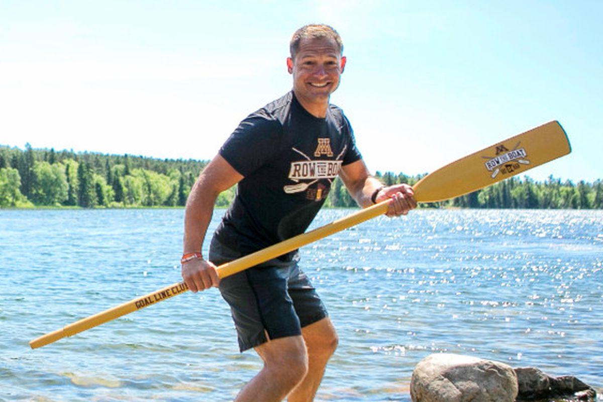 P.J. Fleck holding an oar