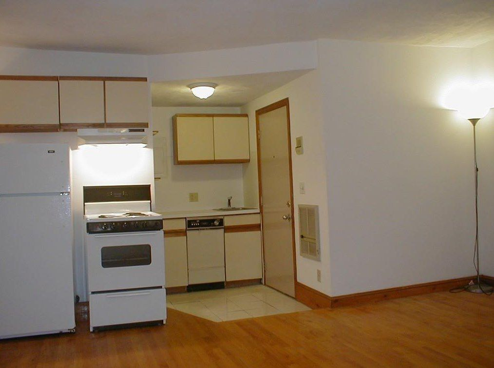 Facing an open kitchen that's small.