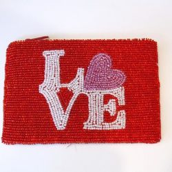 """<a href=""""http://weheartphilly.bigcartel.com/product/love-beaded-purse"""">Love Beaded Purse</a>, $26 at Verde and Open House boutiques"""