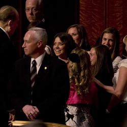 A group of young women meet President Thomas S. Monson as he exits the stage area. Thousands of young women attend general Young Women's meeting of The Church of Jesus Christ of Latter-day Saints on Saturday, March 24, 2012, at the Conference Center in Salt Lake City.