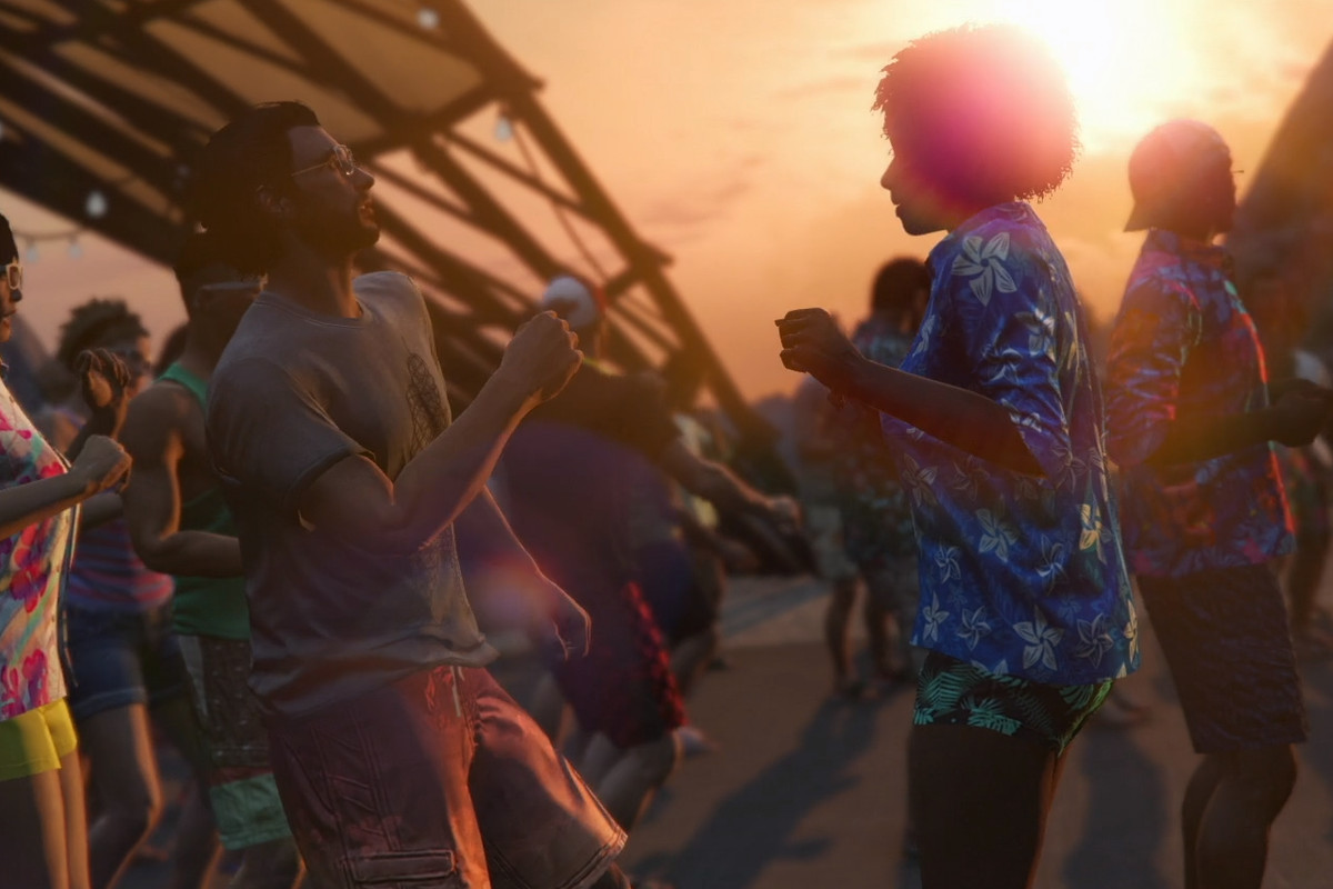 Grand Theft Auto Online - partygoers dance on a beach in Cayo Perico