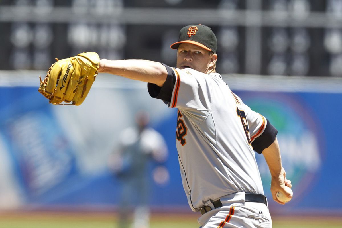 OAKLAND, CA - JUNE 24: Matt Cain #18 of the San Francisco Giants pitches against the Oakland Athletics during the first inning of an interleague game at O.co Coliseum on June 24, 2012 in Oakland, California.  (Photo by Jason O. Watson/Getty Images)