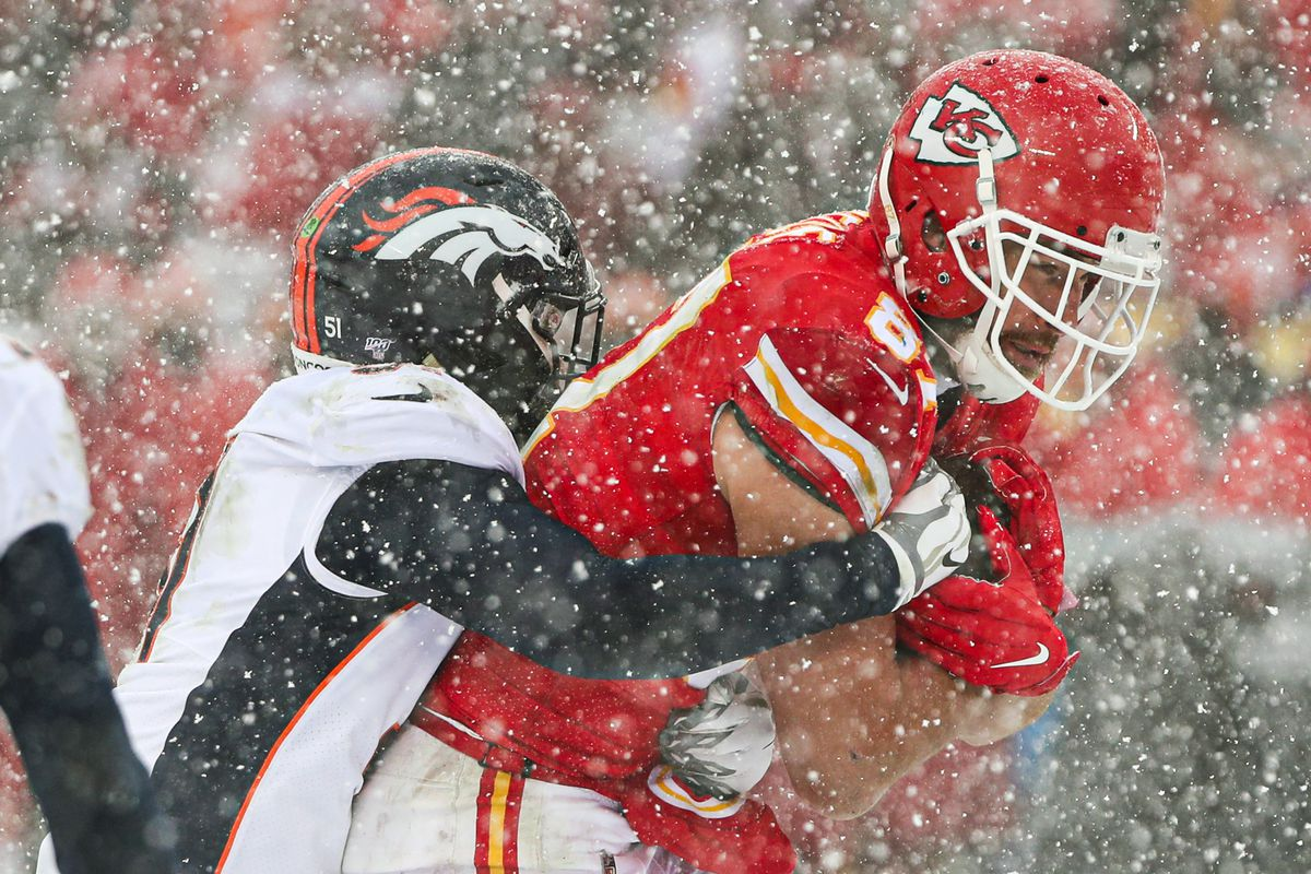 Kansas City Chiefs tight end Travis Kelce is tackled by Denver Broncos inside linebacker Todd Davis during the second half at Arrowhead Stadium.