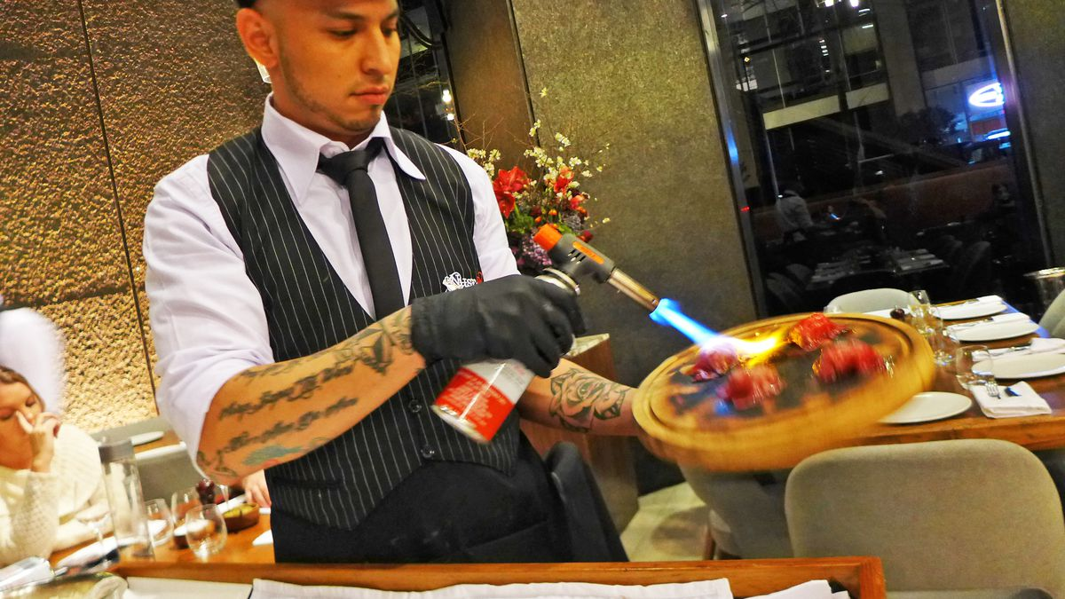 It takes skill — and a blowtorch — to make the special sushi at Nusr-Et, one of this year's 10 worst dishes.