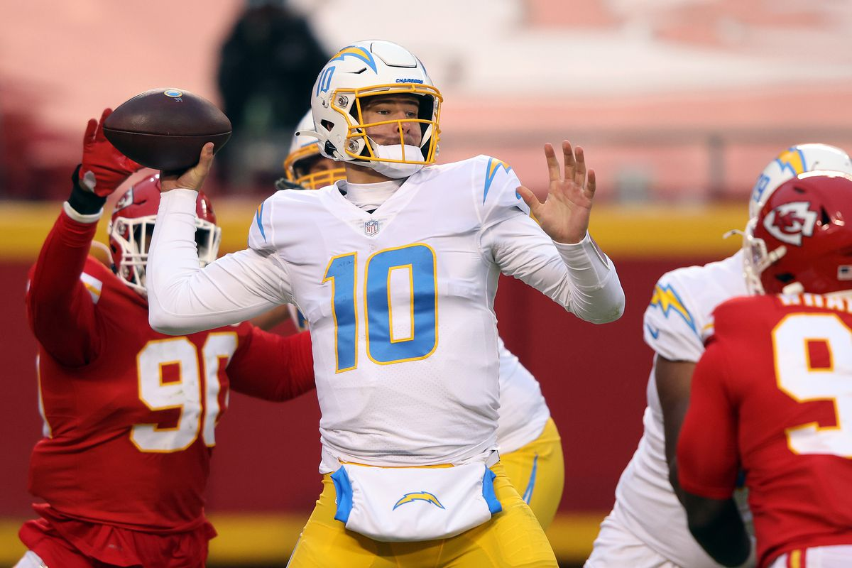Quarterback Justin Herbert #10 of the Los Angeles Chargers passes during the game against the Kansas City Chiefs at Arrowhead Stadium on January 03, 2021 in Kansas City, Missouri.