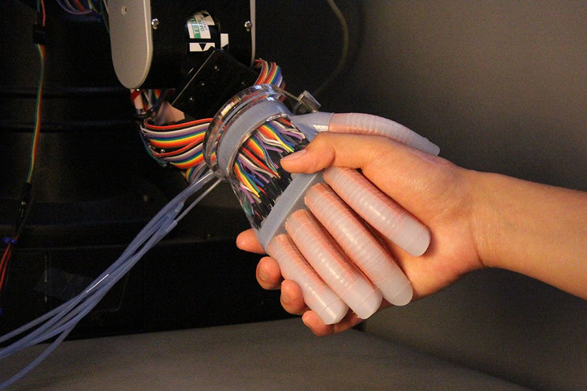 Here's a robotic hand that handles objects as delicately as a human