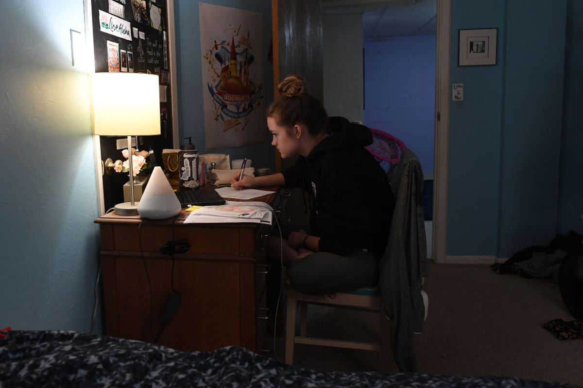 LAKEWOOD, COLORADO - MARCH 17: Fifteen-year-old Campbell Preston, a high school freshman in Jeffco Public Schools, works on doing her first day of online learning in her room at her family's home on March 17, 2020 in Lakewood, Colorado. (Photo by  RJ Sangosti/MediaNews Group/The Denver Post via Getty Images)