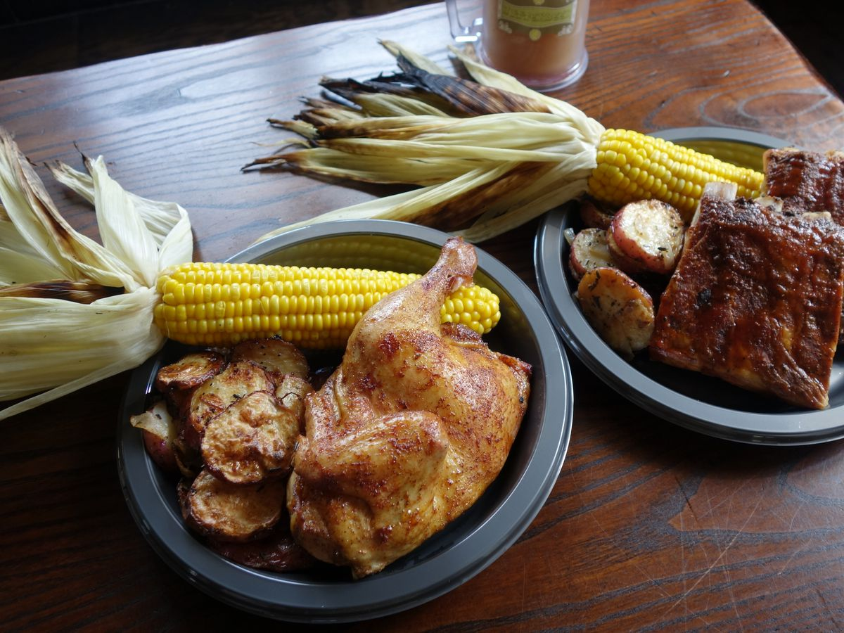 Smoked chicken and spare ribs platters at Three Broomsticks