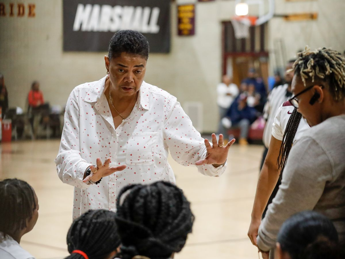 Marshall's coach Dorothy Gaters talks to her players.