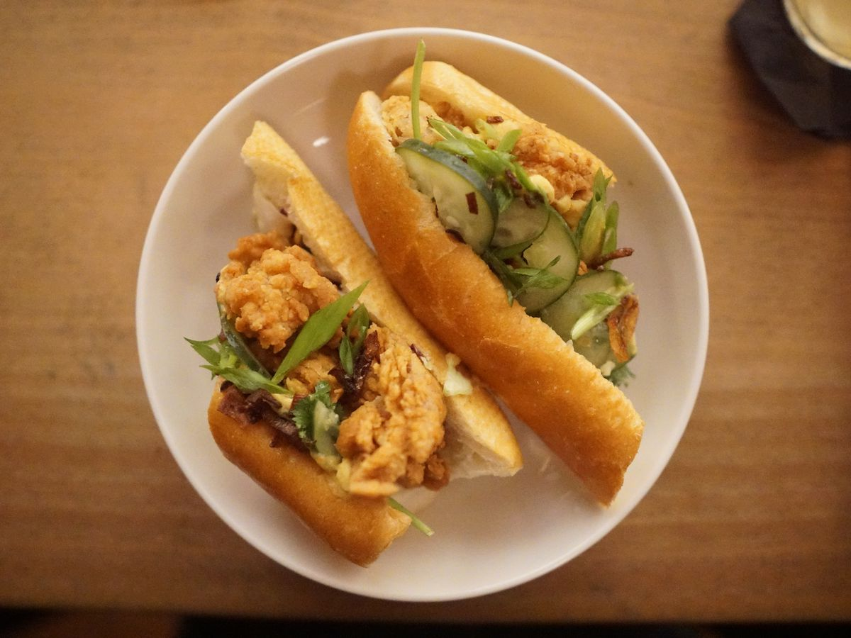 fried chicken, house fermented hot sauce, nước chấm aioli, pickled shallots, cilantro and scallion, on a baguette from the incomparable binh minh bakery