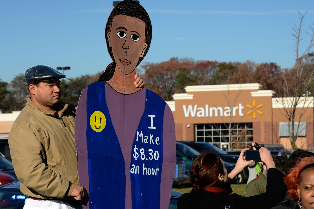 UFCW members protest Walmart business practices in November 2012 in Maryland. (Photo by Bill O'Leary/the Washington Post via Getty Images)