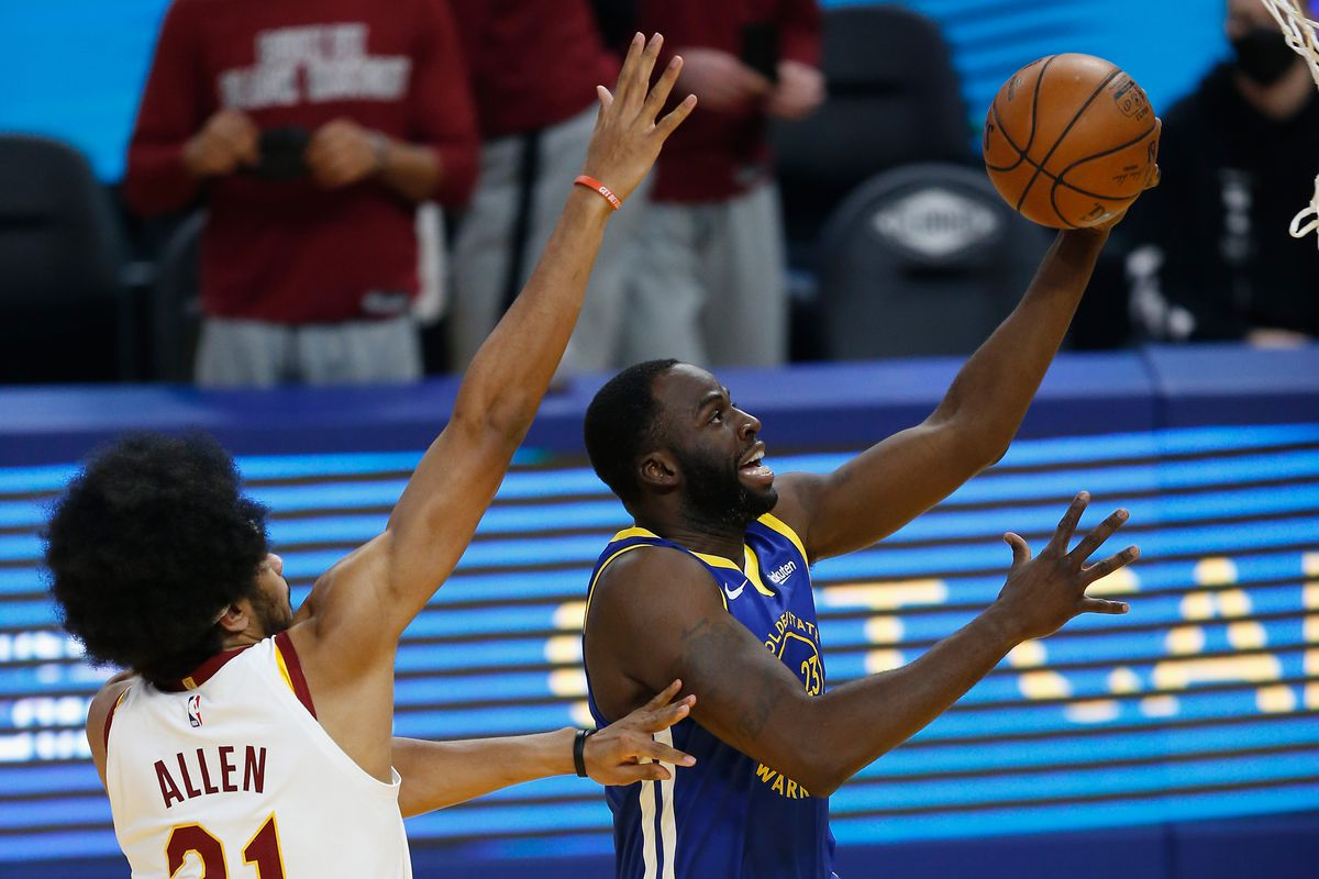 Draymond Green of the Golden State Warriors goes to the basket against Jarrett Allen of the Cleveland Cavaliers in the first quarter at Chase Center on February 15, 2021 in San Francisco, California.