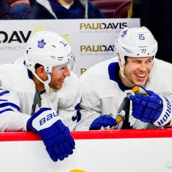 Martin and Leivo sharing a moment on the bench
