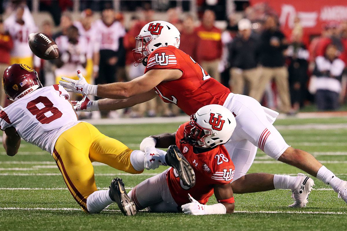 Utah Utes linebacker Chase Hansen pulls in an interception with defensive back Javelin K. Guidry and USC Trojans wide receiver Amon-Ra St. Brown at bottom and left during NCAA football in Salt Lake City on Saturday, Oct. 20, 2018.