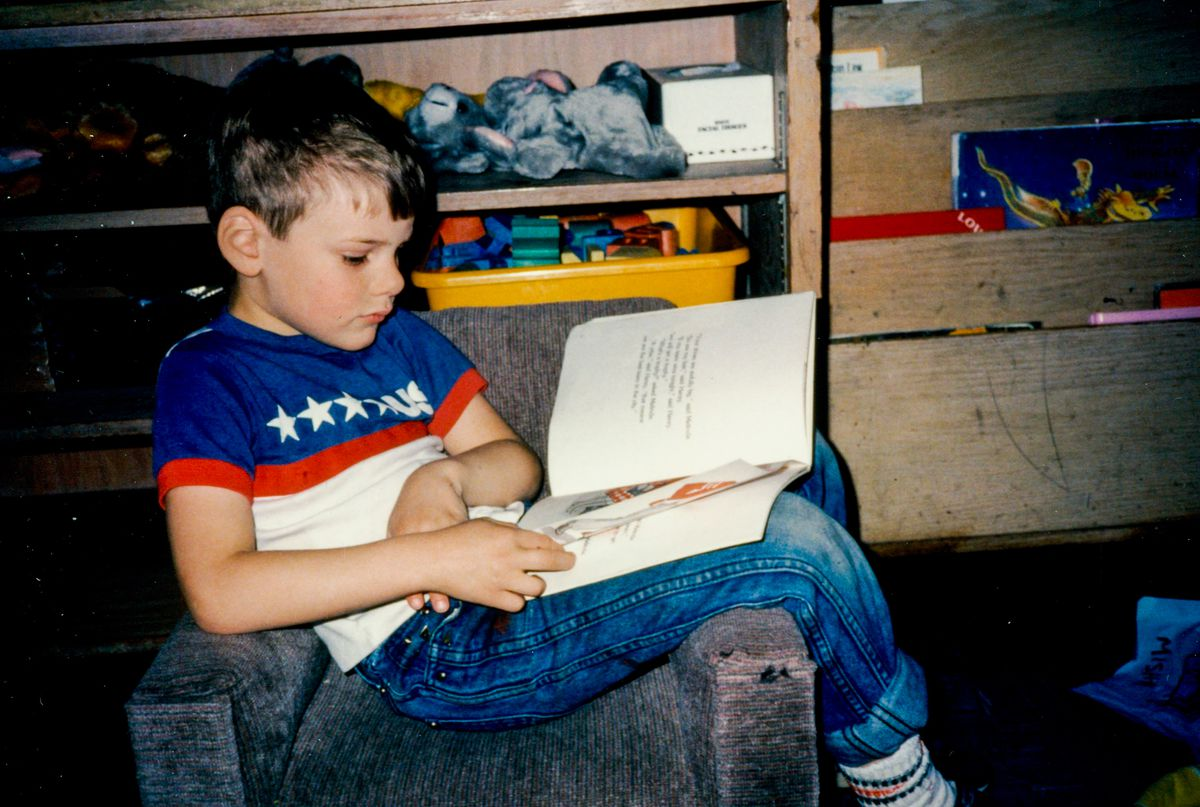 On his sixth birthday, Chesa Boudin reading a book in New York. He moved to Chicago the following year with adoptive parents Bill Ayers and Bernardine Dohrn.