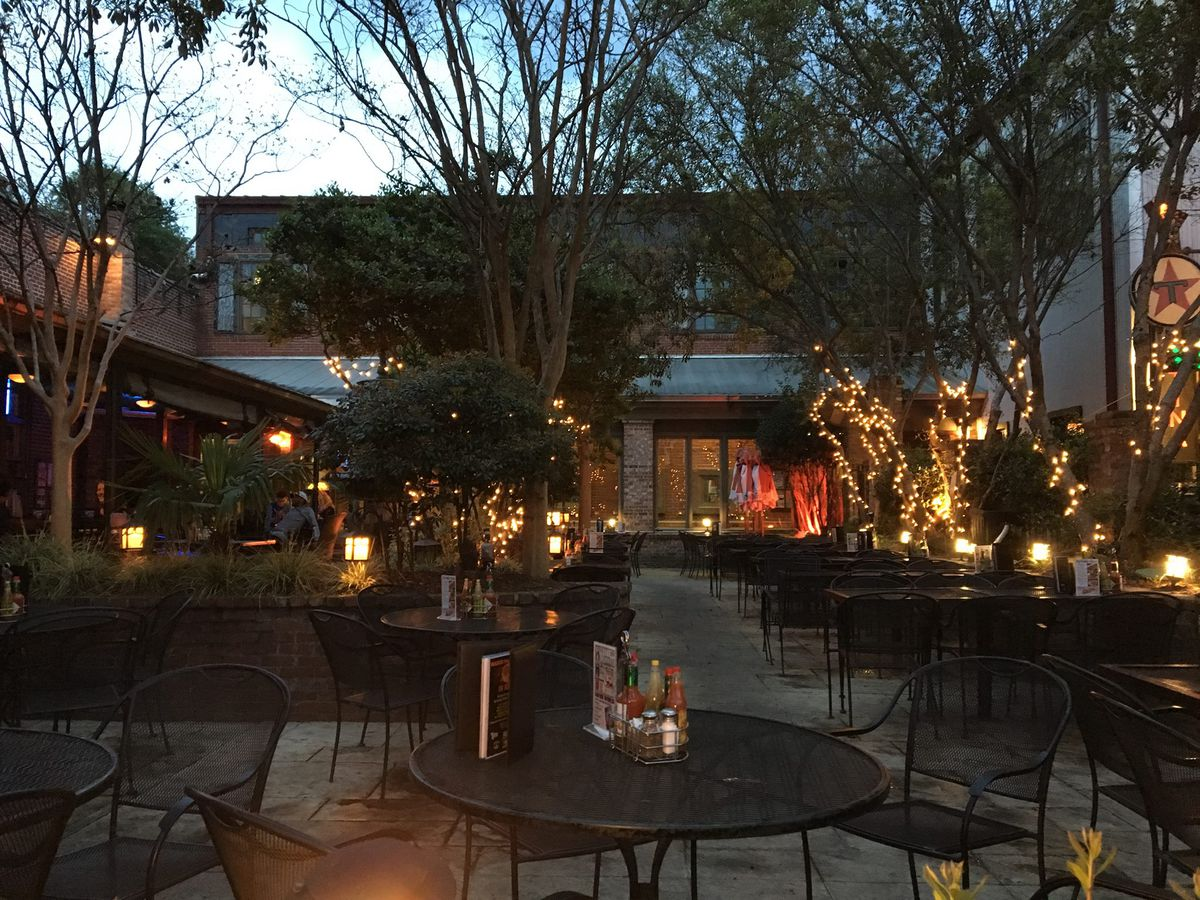The outdoor patio lit up by string lights at Front Page News on Moreland in Atlanta