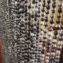 Tahiti is known for its black pearls. This beaded curtain was made by <b>Robert Wan</b>, a well-known local pearl producer, of imperfects.