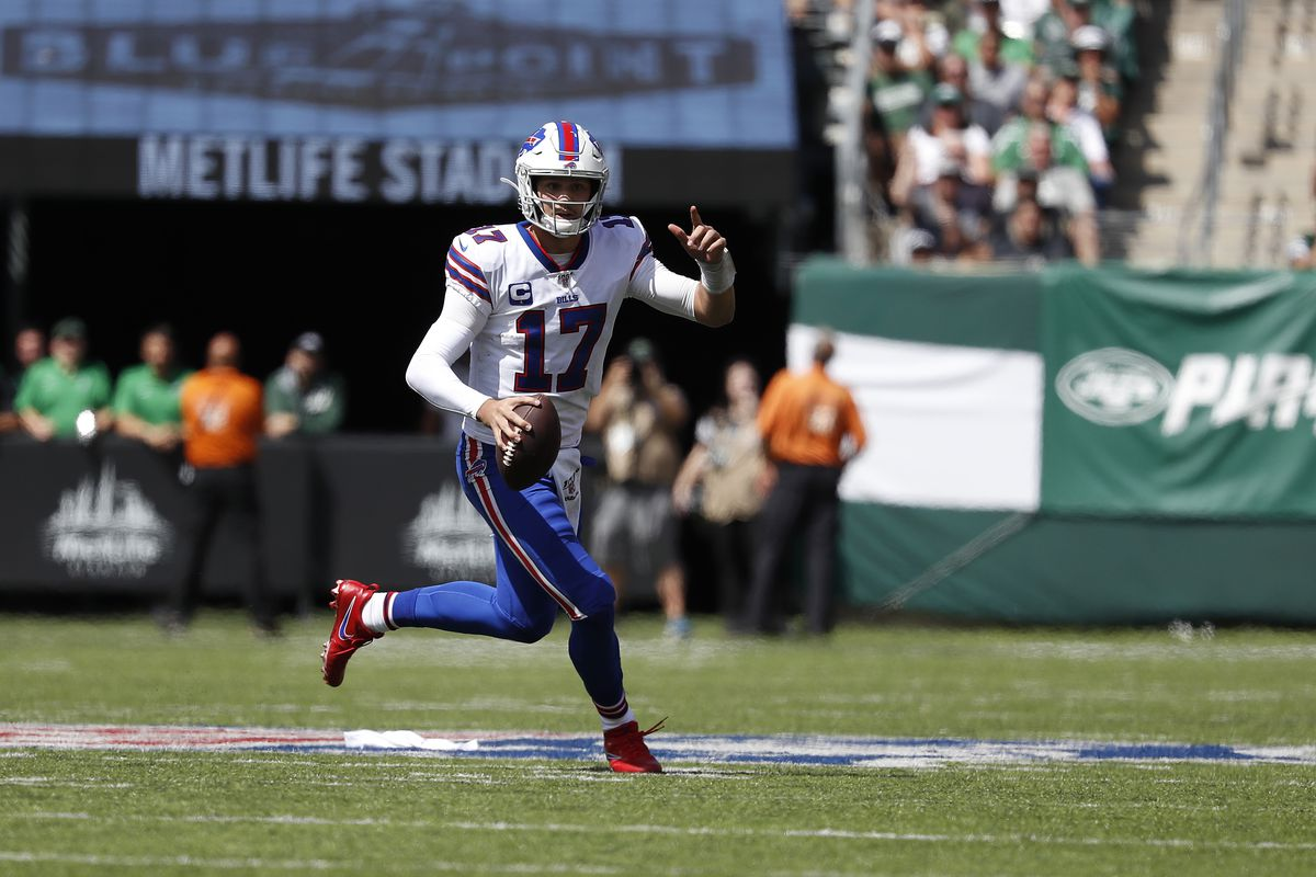 Buffalo Bills quarterback Josh Allen rolls out to pass the ball during a game against the New York Jets during the first quarter at MetLife Stadium on September 08, 2019 in East Rutherford, New Jersey.