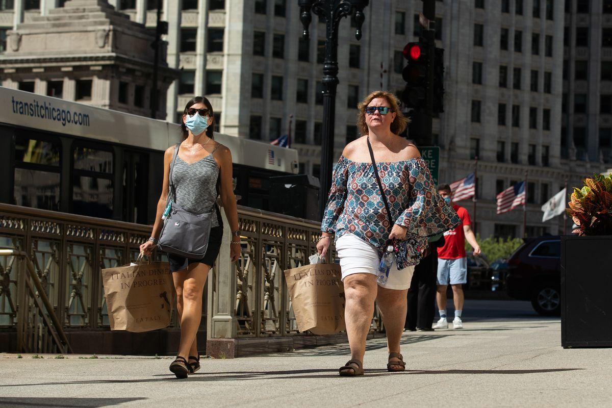 People walk in the Loop Wednesday afternoon, Aug. 19, 2020.