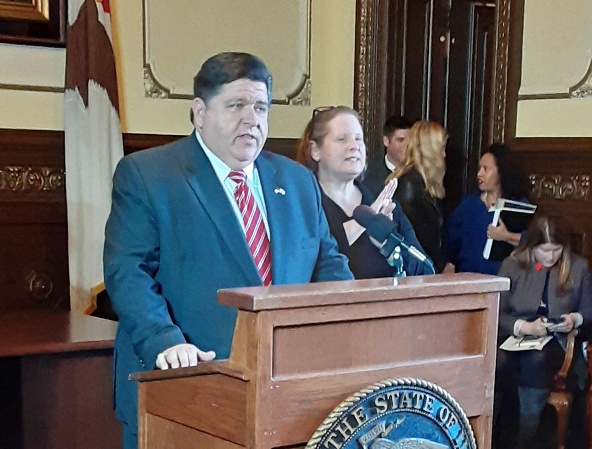 Illinois Gov. J.B. Pritzker speaking at a news conference.