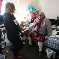 Douglas Henderson talks with assistant Janelle Bailey about moving after he and his wife were evicted from their apartment in South Salt Lake on Tuesday, Jan. 12, 2021.