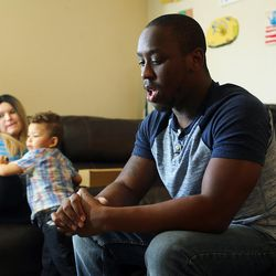 Lamar Ross, right, talks about how his family believes his uncle, Patrick Harmon, was murdered as Ross' wife, Chayse Maryie, and son, Jorrick, look on while sitting in their Ogden home on Monday, Oct. 9, 2017. Harmon was shot and killed by a Salt Lake City police officer in August.
