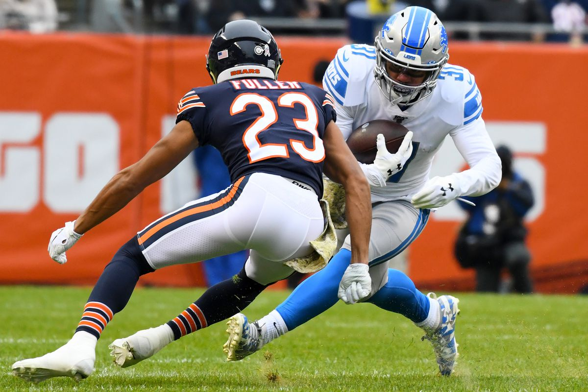 Chicago Bears cornerback Kyle Fuller makes a tackle on Detroit Lions running back Ty Johnson during the first quarter at Soldier Field.